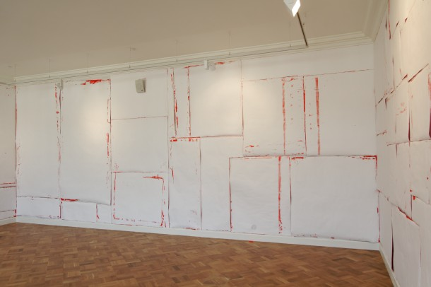"""Joëlle Tuerlinckx The (Red) Room Adaptation of """"A Stretch Museum Scale 1:1"""", 2002 2014 Installation, color paper, text"""
