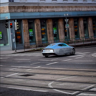 Leaving town with a retrofuturistic VW #XL1 Super Efficient Vehicle