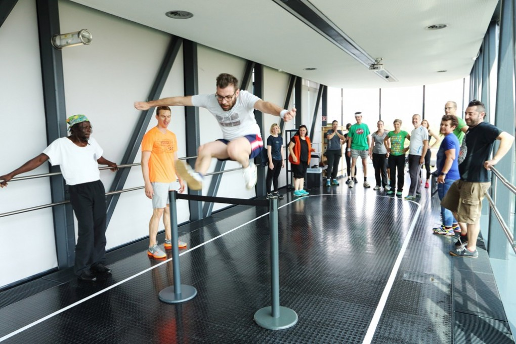 "Aldo Giannotti jumping a hurdle in Kunsthaus Graz during the opening of his project ""The Museum as a Gym"", (c) Aldo Giannotti"