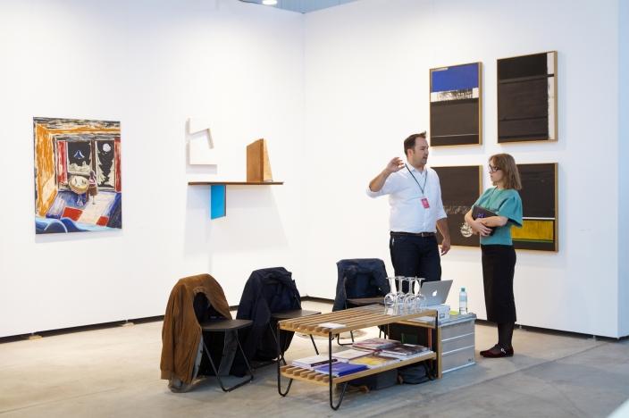Gallerist Rod Barton (left) at his booth, photo (c) viennacontemporary / Margarita Ignatyuk