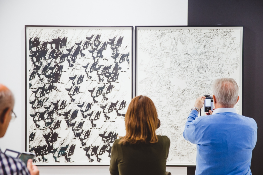 Fair visitors taking pictures of Peter Jellitsch's works, photo (c) viennacontemporary / Alexander Murashkin